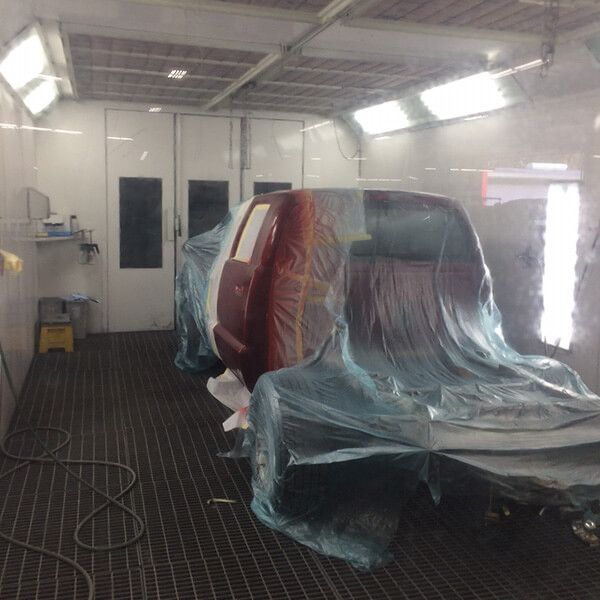 truck in the paint booth at Precision AutoCraft